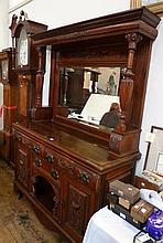 An Edwardian walnut mirrorback sideboard, fret