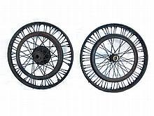 Two Vintage motorcycle wheels