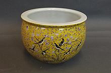 A Chinese yellow enamelled pottery jardinière