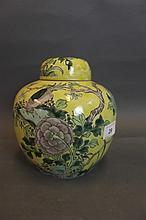 A Chinese yellow ground pottery jar and cover
