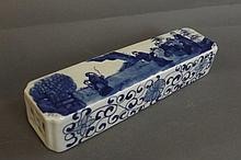 A Chinese blue and white wrist rest with pierced