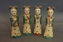 Four Chinese earthenware terracotta dolls playing