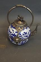 A Chinese blue and white pottery teapot with a