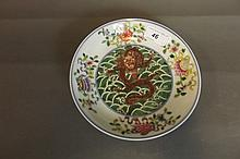 A Chinese porcelain shallow dish painted in