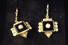 A 9ct gold pair of onyx and seed pearl earrings in