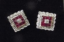 A pair of 9ct gold, ruby and diamond stud earrings