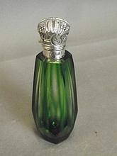 A green glass scent bottle with a Continental