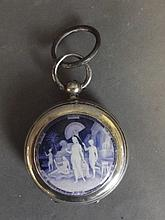 A silver pocket watch with an applied blue and