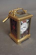 A miniature brass bound carriage clock with