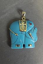 An 18ct gold mounted turquoise pendant in the form