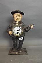 A painted cast iron automaton mantle clock in the