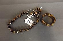 A tiger's eye bead necklace and bracelet