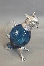 A silver plate and blue coloured glass claret jug