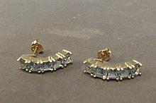 A pair of 9ct gold half hoop earrings set with