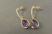 A pair of 18ct amethyst and diamond drop earrings