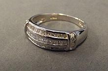 A 14ct white gold three row diamond ring, size P