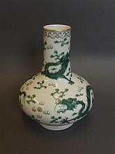 A Chinese porcelain vase decorated with green