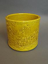 A Chinese yellow ground brush pot with relief