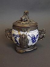 A Chinese metal bound blue and white pottery twin