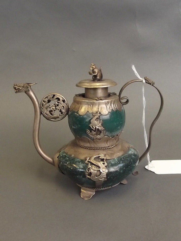 A Chinese White Metal Bound Stone Teapot With Applied Metal