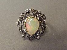 A 14ct gold pear shaped opal and old cut diamond
