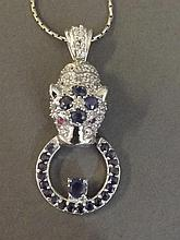 A silver and sapphire set necklace in the form of