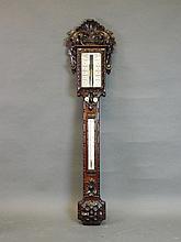 A large Victorian carved mahogany framed barometer