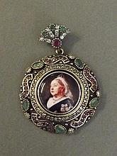 An enamelled silver pendant depicting Queen