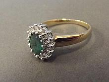 A 9ct gold, emerald and diamond set dress ring,