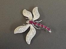 A silver and real ruby set brooch in the form of a