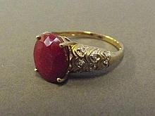 A 9ct gold dress ring set with central ruby and