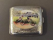 A heavily decorated silver cigarette case with
