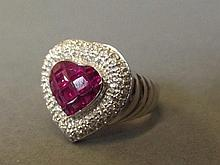 An 18ct white gold, ruby and diamond heart shaped