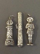 Three ornate Continental silver needle cases, 3''