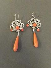 A 9ct gold and silver set with coral drop earrings