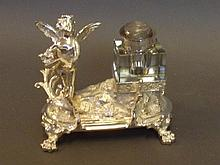 A silver plated inkstand in the form of a winged