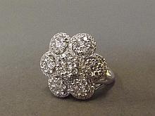 An 18ct white gold seven diamond cluster flower