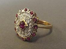 A 9ct gold ruby and diamond oval panel dress ring,