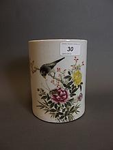 A Chinese pottery brushpot painted with a bird