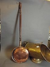 An early C20th ornate brass coal scuttle, 18