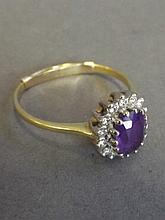 An 18ct gold, amethyst and 14 diamond set ring,