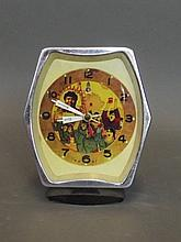 A shaped Chinese alarm clock depicting chairman