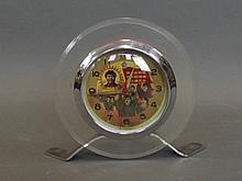 A circular Chinese alarm clock depicting chairman