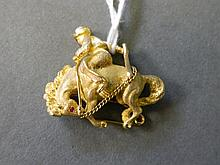 An 18ct gold brooch in the form of a gaucho on a