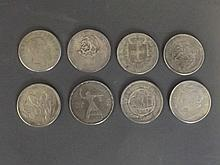 A set of 8 assorted silvered metal world coins