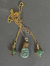 Three apple green jade pendants on necklaces