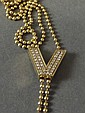 A heavy 18ct gold Versace necklace set with