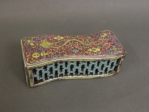 A Chinese famille rose style pierced wrist rest