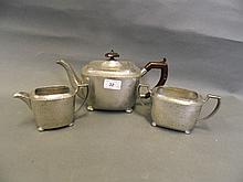 An early C20th hammered pewter 3 piece tea