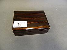 A Japanese lacquer box with simulated serpentine